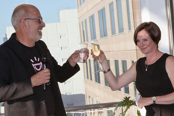 Ecostore founder and Executive Chair of Fairground Foundation Malcolm Rands makes a toast to the NSPR Team, pictured with Niki Schuck