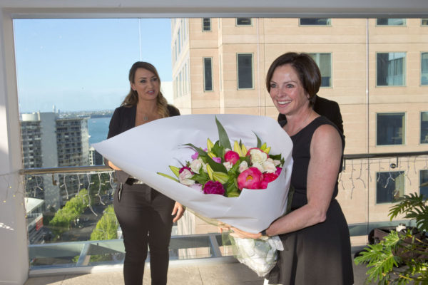 Niki Schuck receiving flowers from NSPR client Event Holdings